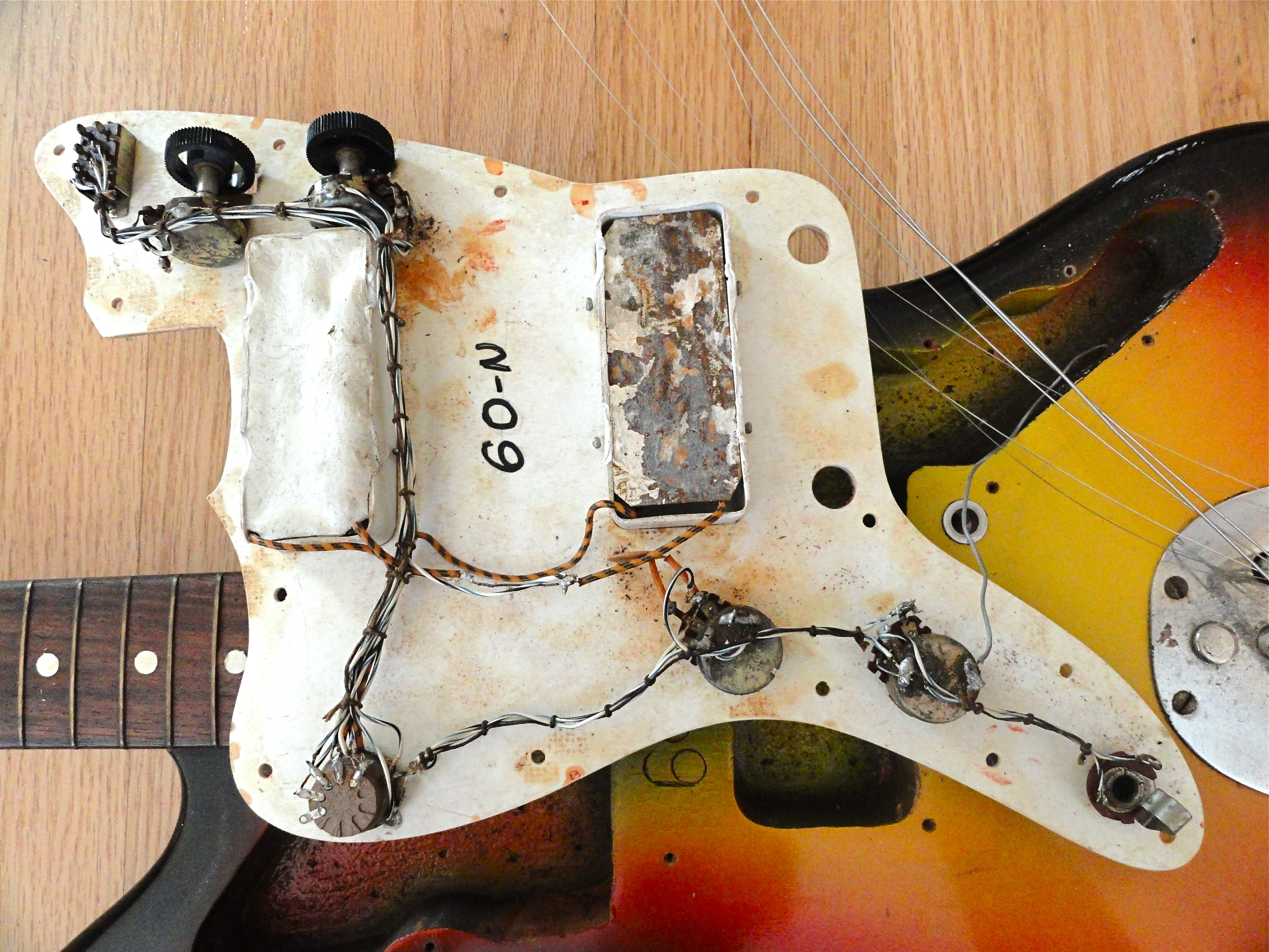 electronically the guitar is an elegant mess and while both pickups work the stock five way rotary switch which is in the place of the normal three way