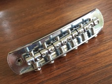 The stock Squier VI bridge